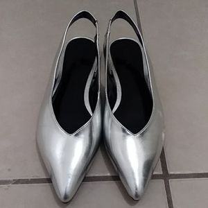 Silver pointy flats